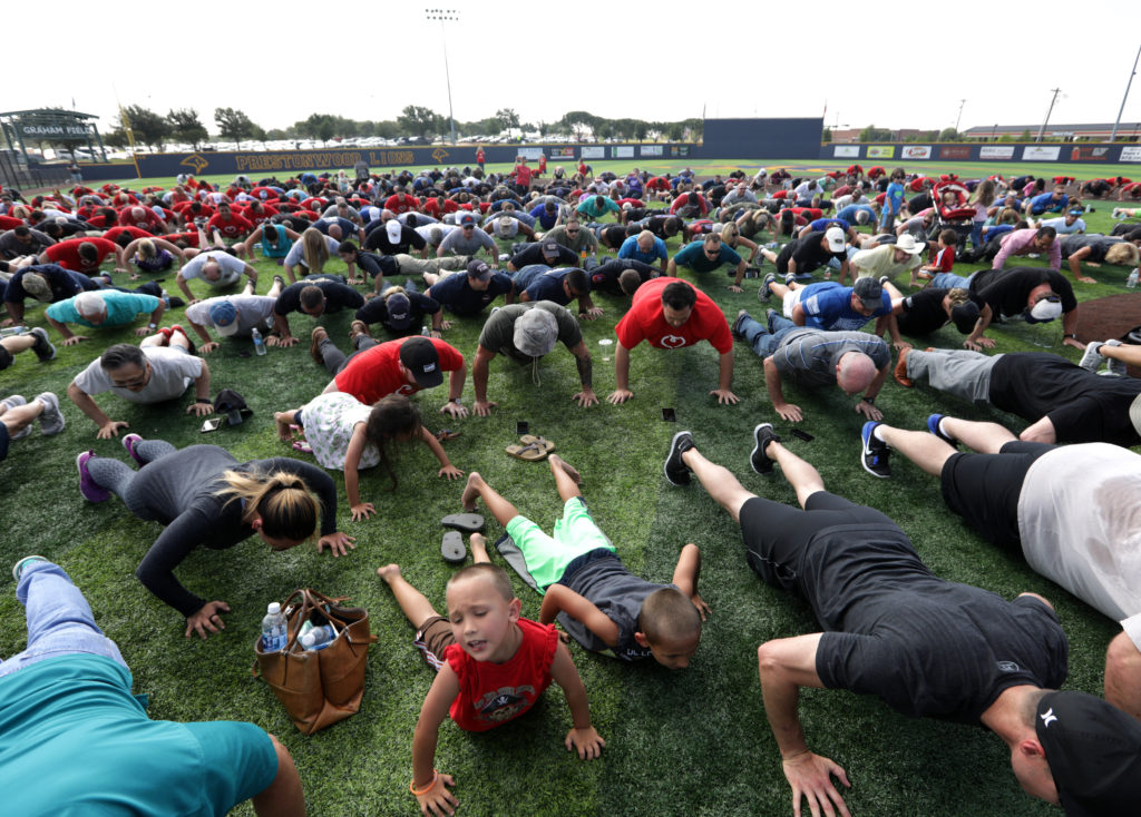 Community members gather to participate in a 22 pushup challenge  as part of the Serving Our Heroes Day celebration at Prestonwood Baptist Church in Plano, TX, on May 31, 2017. (Jason Janik/Special Contributor)